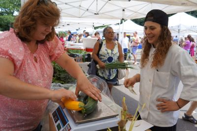 Chef Samantha of Tarry Lodge purchases squash from Patti Popp of Sport Hill Farm at the Westport Farmers Market